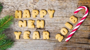 85361182 - happy new year note written with cookie letters